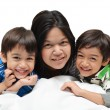 Stock Photo: Mother And Sons Lying In Bed Together