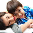 Stock Photo: Little boy sibling lying together