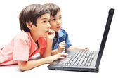 Little sibling boys use laptop for education on white background — Stock Photo