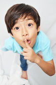 Little 6 years boy mix portrait finger on mouth — Stock Photo