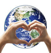 Love hand make heart shape on earth — Stock Photo