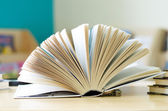 books opened on the table — Stock Photo