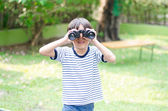 Little boy looking trough a binoculars — Stock Photo