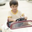 Little boy driving a little car on the road — Stock Photo #46587847
