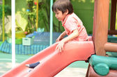Little boy sliding outdoor play time — Stock Photo