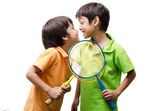 Little sibling boy holding badminton racket for play — Stock Photo