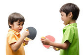 Little boys playing table tennis on white background — Stock Photo