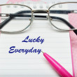 Pink pen notebook and glasses — Stock Photo #48650149