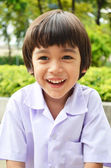 Little cute boy smiling in the garden — Stock Photo