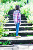 Little boy walking on Stairs going uphill — Stok fotoğraf