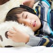 Little boy listening the music with headset while sleeping — Stock Photo #50275307