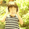Little boy listening the sound of nature vintage style — Stock Photo #50275381