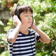 Little boy listening the sound of nature — Stock Photo #50275411
