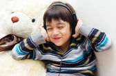 Little boy listening the music with headset — Stock Photo