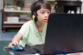 Little boy playing pc game at home — Stock Photo