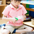 Little boy cutting paper of montessori educational — Stock Photo #51712267
