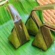 Thai style dessert made from Steamed Flour with Filling inside wrapped with banana leaf, Khanom Sod-Sai — Stock Photo