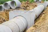 Concrete drainage pipe and manhole under construction — Stock Photo