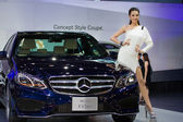 Unidentified modelling posted over Mercedes Benz Concept Style Coupe — Stock Photo