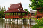 Thai style house in the water — Stock Photo