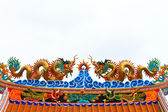 Two dragons on chinese temple roof — Stock Photo