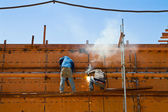 Worker building ship — Stock Photo