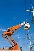 Worker repairing power line — Stock Photo