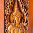 Thai style wood carving on temple door — Stock Photo