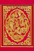 Golden dragon decorated on chinese temple door — Stock Photo