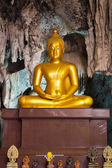 Buddha statue in the cave — Stock Photo