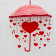 Red umbrella with heart and love letters — Stock Photo