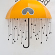 Yellow umbrella with so sad letters — Stock Photo