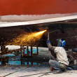 Workers cutting steel hull — Stock Photo