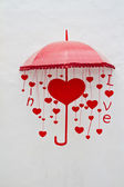 Red umbrella with heart and love letters — Photo