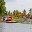 Backhoe working in the canal — Stock Photo