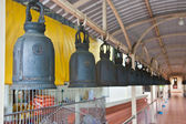 Row of bells in Thai Buddhist temple — Stock Photo