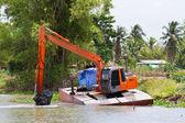Backhoe working in the canal — Foto de Stock
