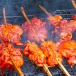 Stock Photo: Grilling chicken on grill