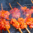 Grilling chicken on the grill — Stock Photo