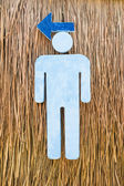 Man sign made of foam on vetiver grass wall — Stock Photo