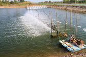 Aerator  in the shrimp farm for fresh water — Stock Photo