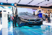 Unidentified modelling posted over BMW i8 — Stock Photo