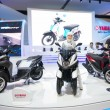 Постер, плакат: Unidentified man and women presenter of new Models YAMAHA Tricity Multi Wheel