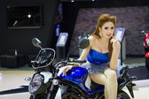 Unidentified model with Suzuki on display — Stock Photo