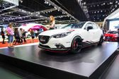 Unidentified model post with new Mazda3 — Stock Photo