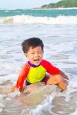 Asian boy on the beach — Stock Photo