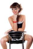 Sexy chambermaid on chair — Stock Photo