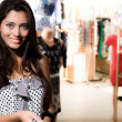 Smiling girl is shopping — Stock Photo