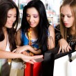 Stock Photo: Three girls are shopping