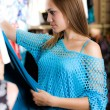 Girl in blue blouse is shopping — Stock Photo #31758213